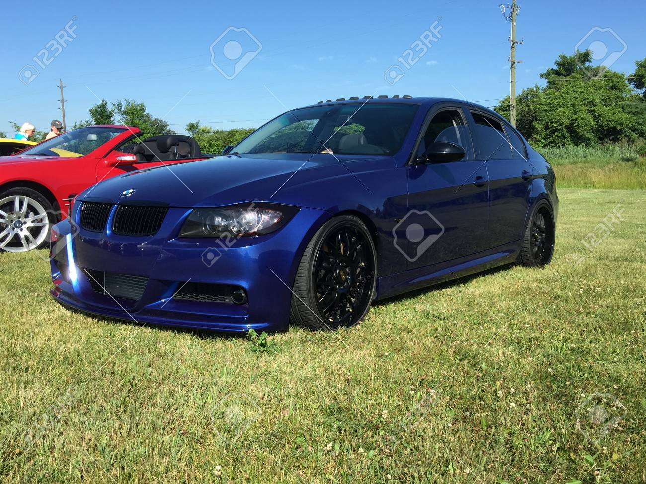 Blue Bmw Sedan With Black Mag Rims At A Cars And Coffee Event Stock Photo Picture And Royalty Free Image Image 105374531