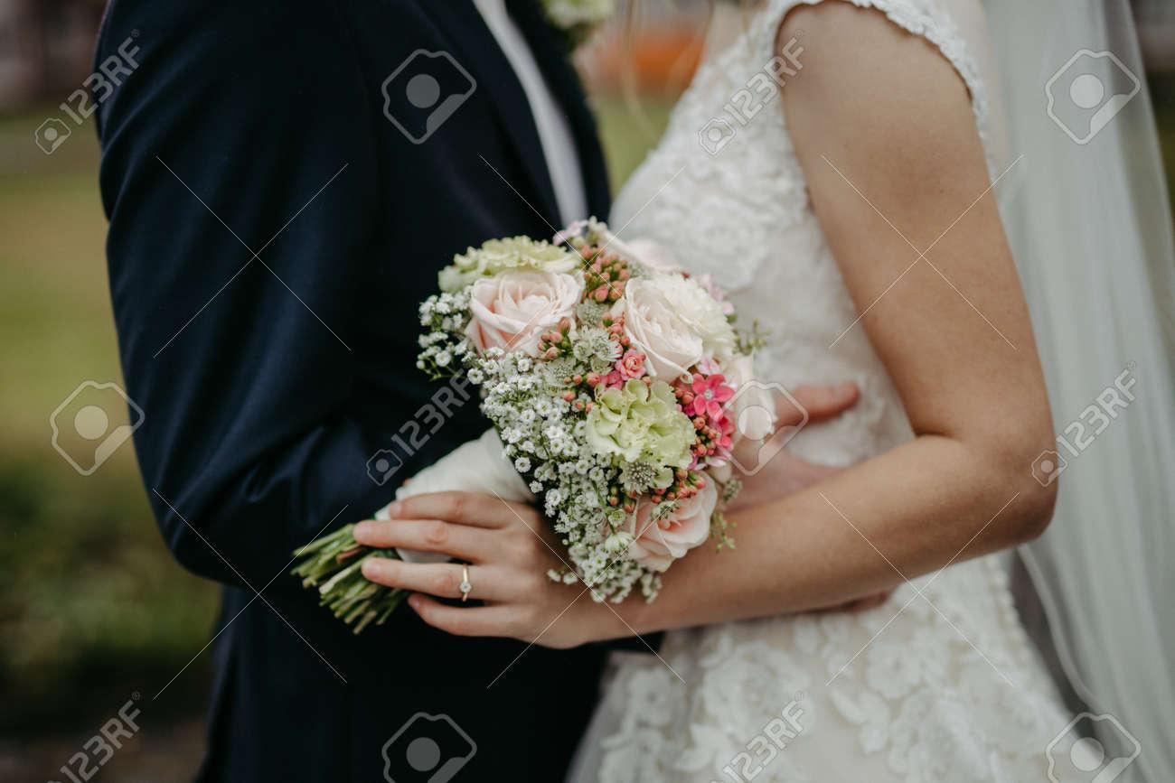 Bride holding flower bouquet close up - 147450440
