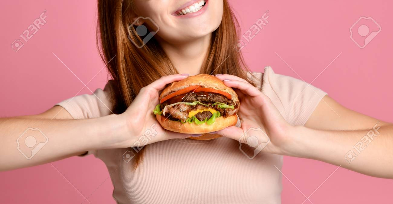cropped photo of beautiful woman with red lips holding a burger