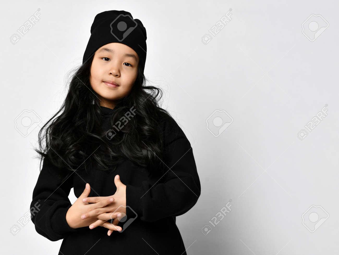 Preteen asian girl posing for camera studio headshot portrait - 166627512