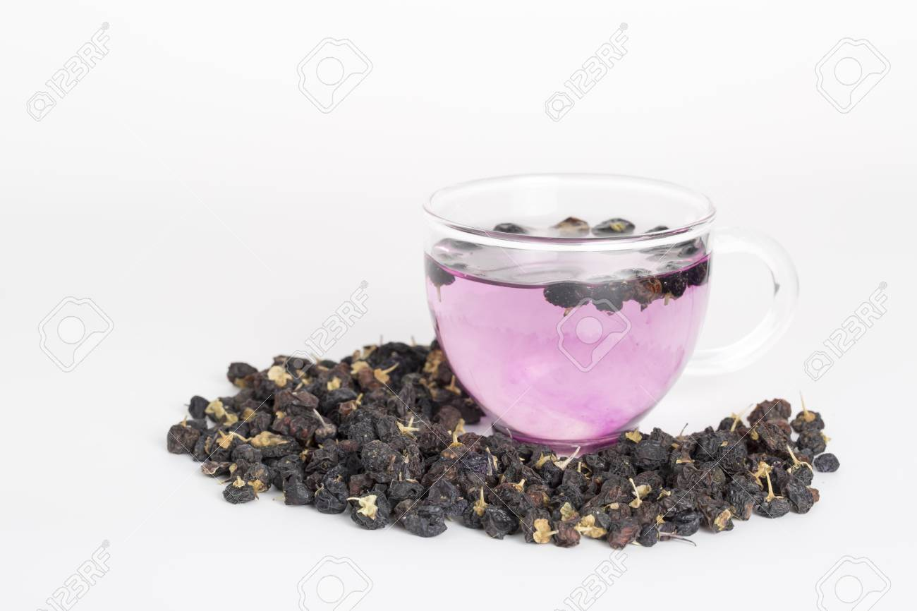 Black Goji Berry Tea On A White Background Stock Photo Picture