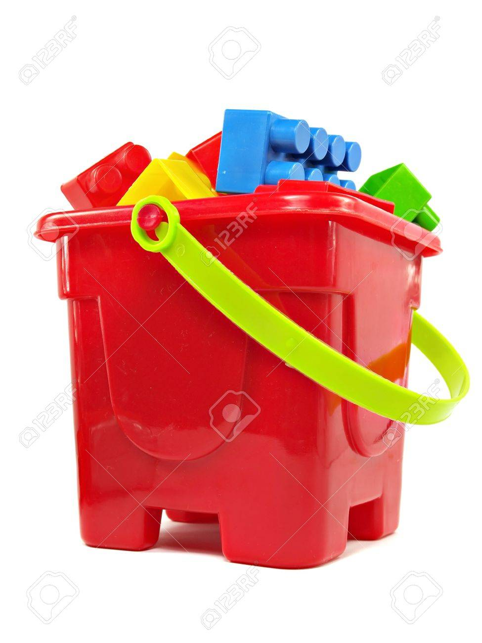 Uncategorized Toy Pail plastic building blocks in red toy pail on a white background stock photo 15554481