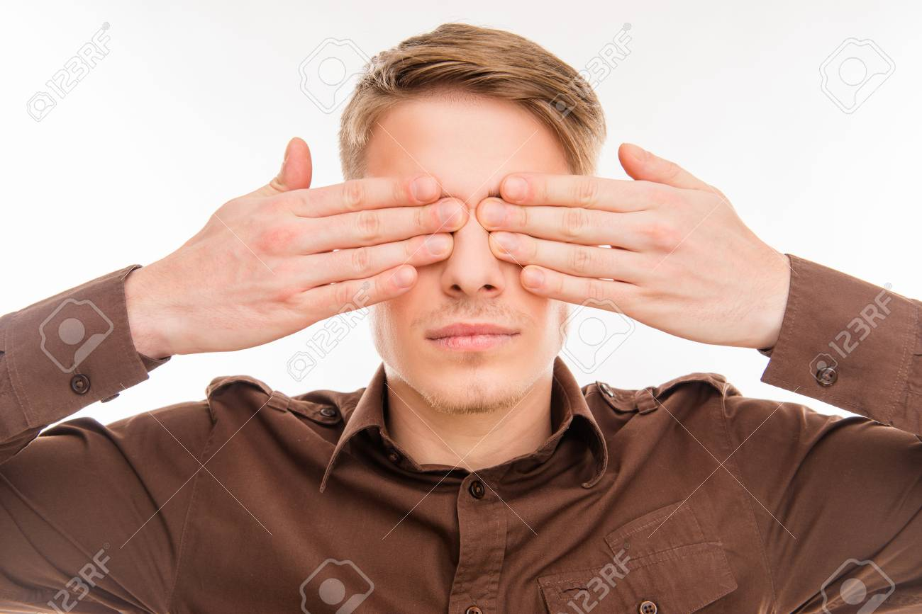 Close Up Photo Of Young Handsome Man Closing His Eyes With Hands