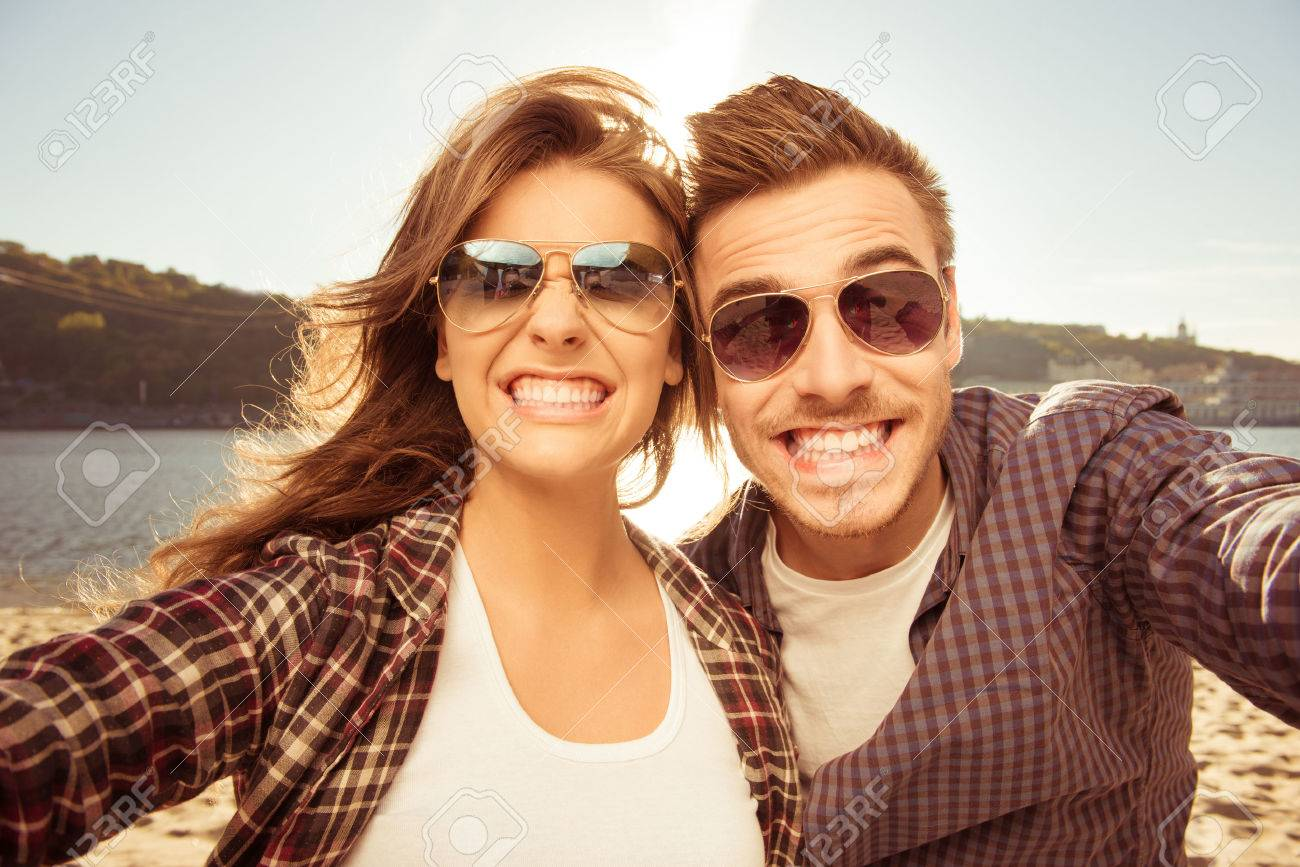 Two lovers making funny selfie - 55107230
