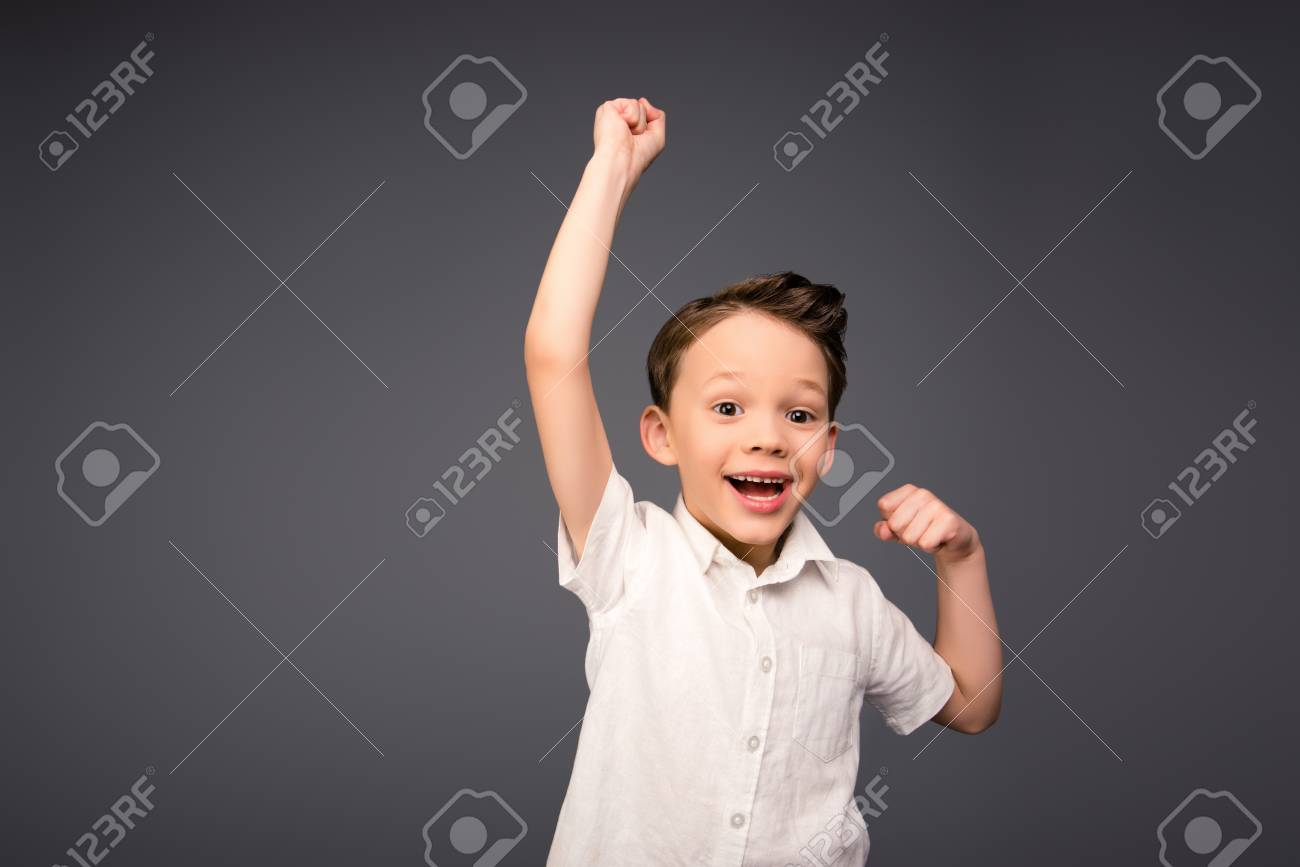 9fbd7a8934901 Yes! Happy Little Boy Triumphing With Raised Hands Stock Photo ...