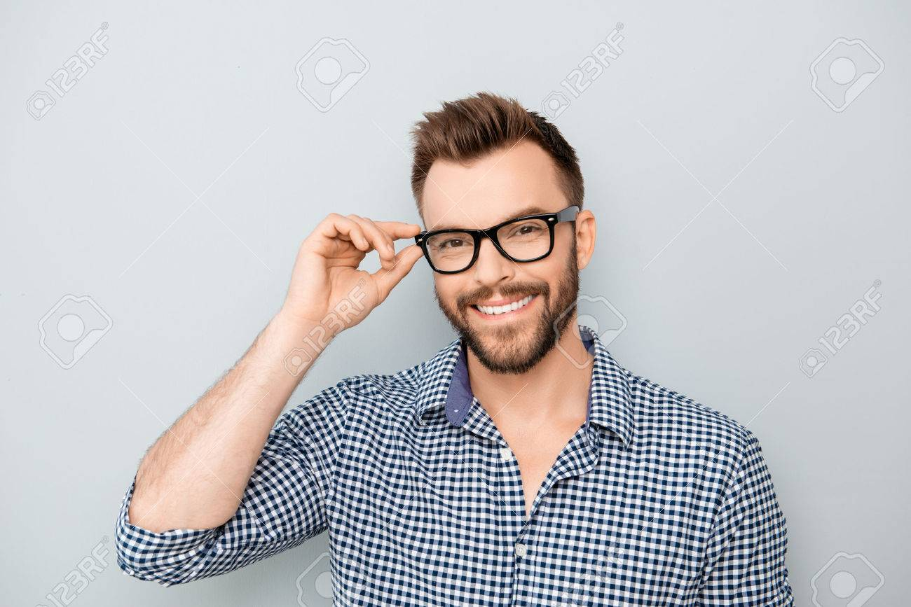 Cheerful smiling young businessman touching his glasses - 59056830