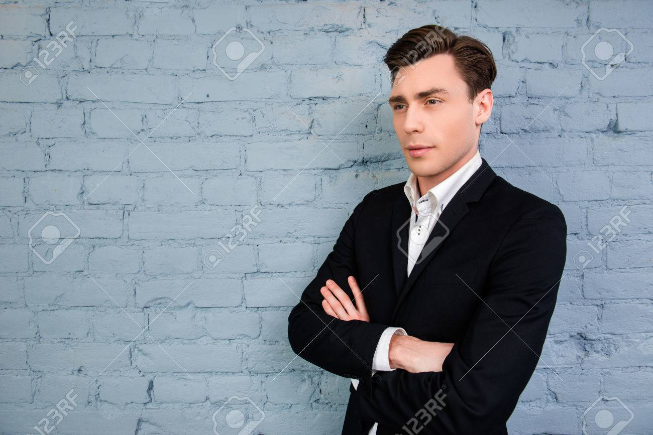 Serious Minded Man In Black Suit With Crossed Hands Stock Photo ...