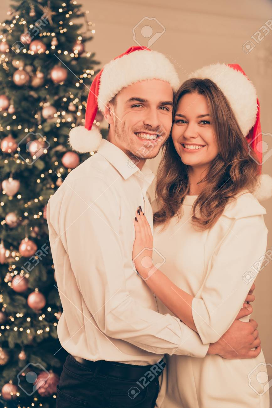 portrait of happy cute couple near christmas tree having celebration stock photo 67191630