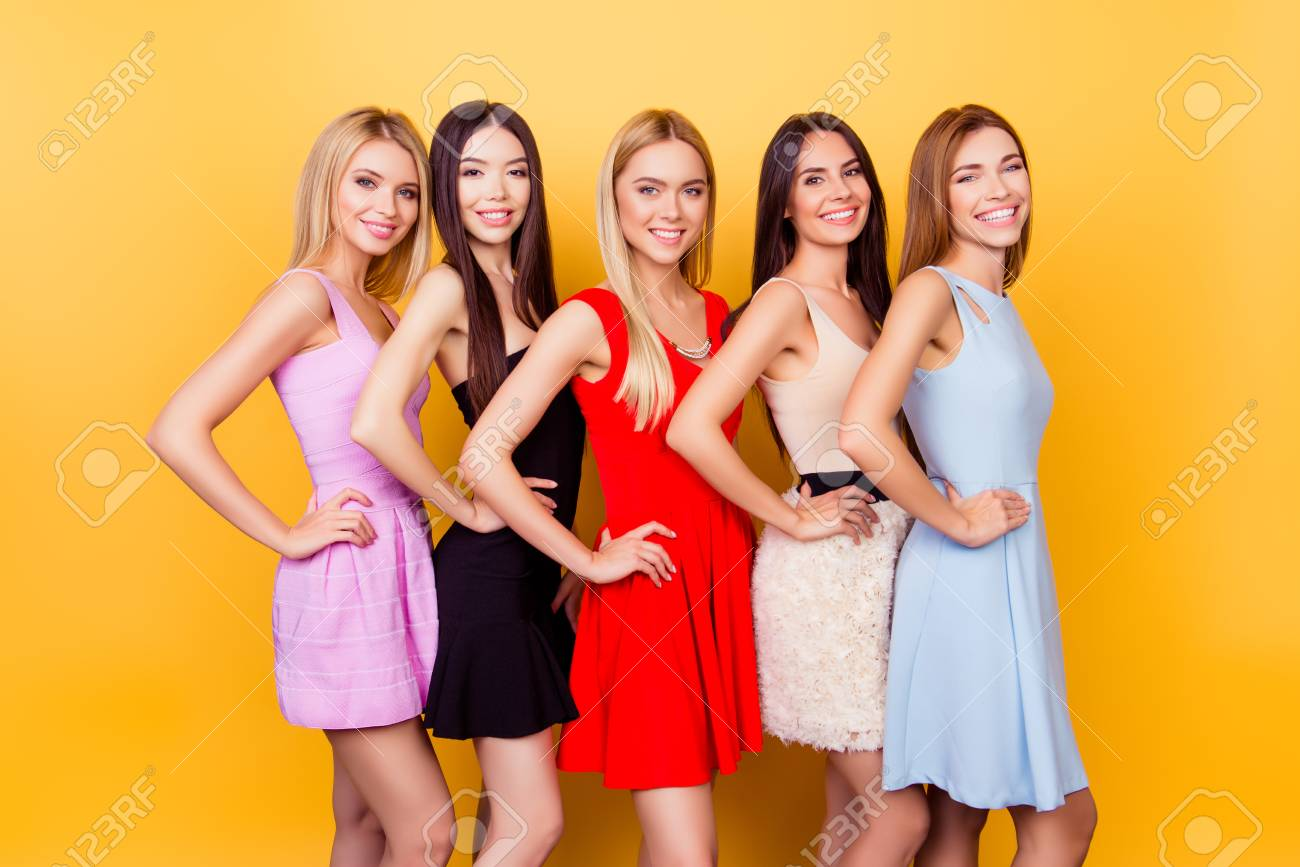 Excited Girlfriends In Colorful Short Cocktail Dresses Are Ready For Birthday Celebration Party Charming And