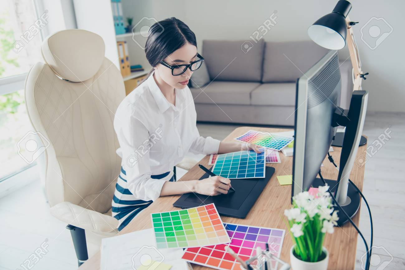Busy Young Asian Graphic Designer Is Drawing Something On Graphic ...