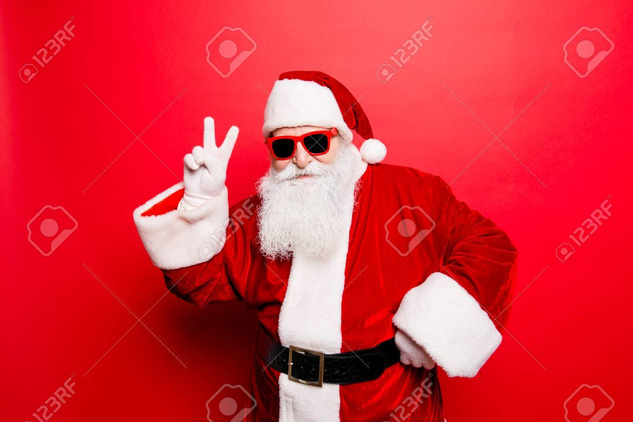 cool funny playful naughty santa grandfather showing peace signs, fooling around, in trendy specs, so confident. - 87597825