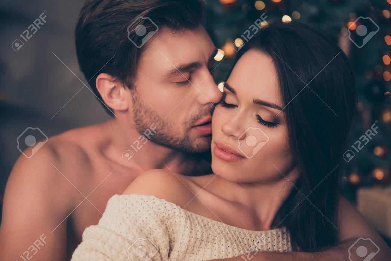 Closeup of brunet partner with bristle hold his brunette from back, cute feelings, temptation pleasure, smooth skin, intense, tender, celebrate christmastime - 89931511