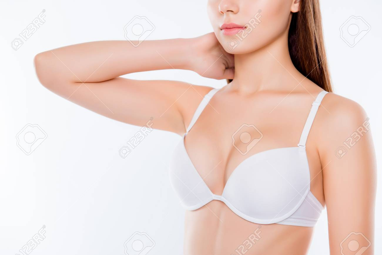 5052aadf7 Cropped close up photo of beautiful woman s breast clothed in white classic  bra cups
