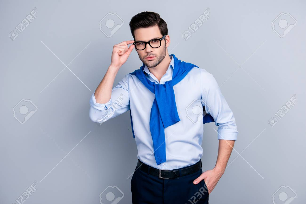 Portrait Of Cool Stunning Guy With Tied Blue Sweater Around Neck