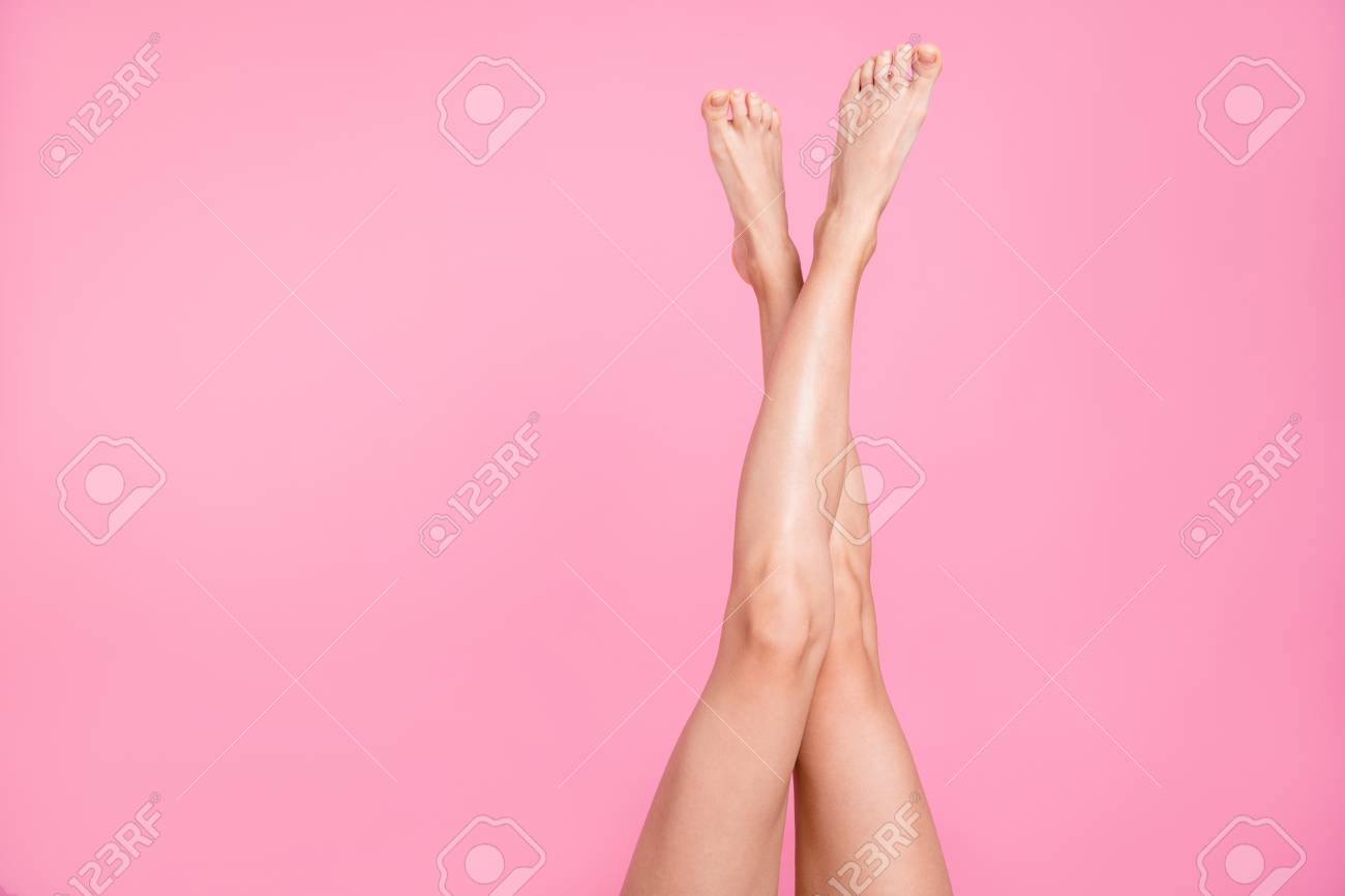 Cropped close-up image view photo of nice perfect long attractive feminine fit thin slim soft smooth shine shaven legs ad advert isolated over pink pastel background - 117125361
