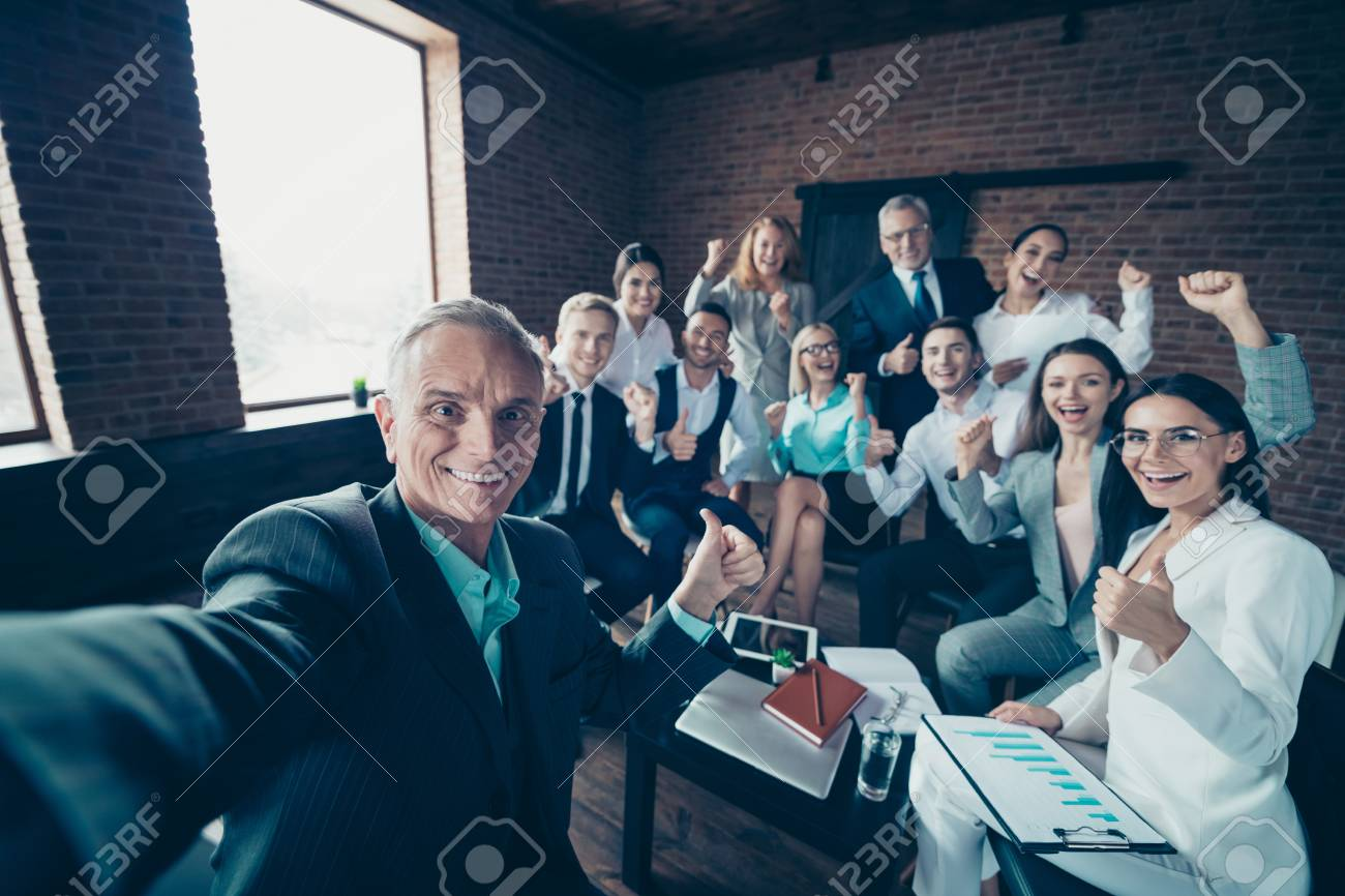 Self-portrait of nice stylish cheerful excited glad executive company staff showing thumbsup yes goal corporate culture agree advice at modern industrial loft interior work place space - 120557458