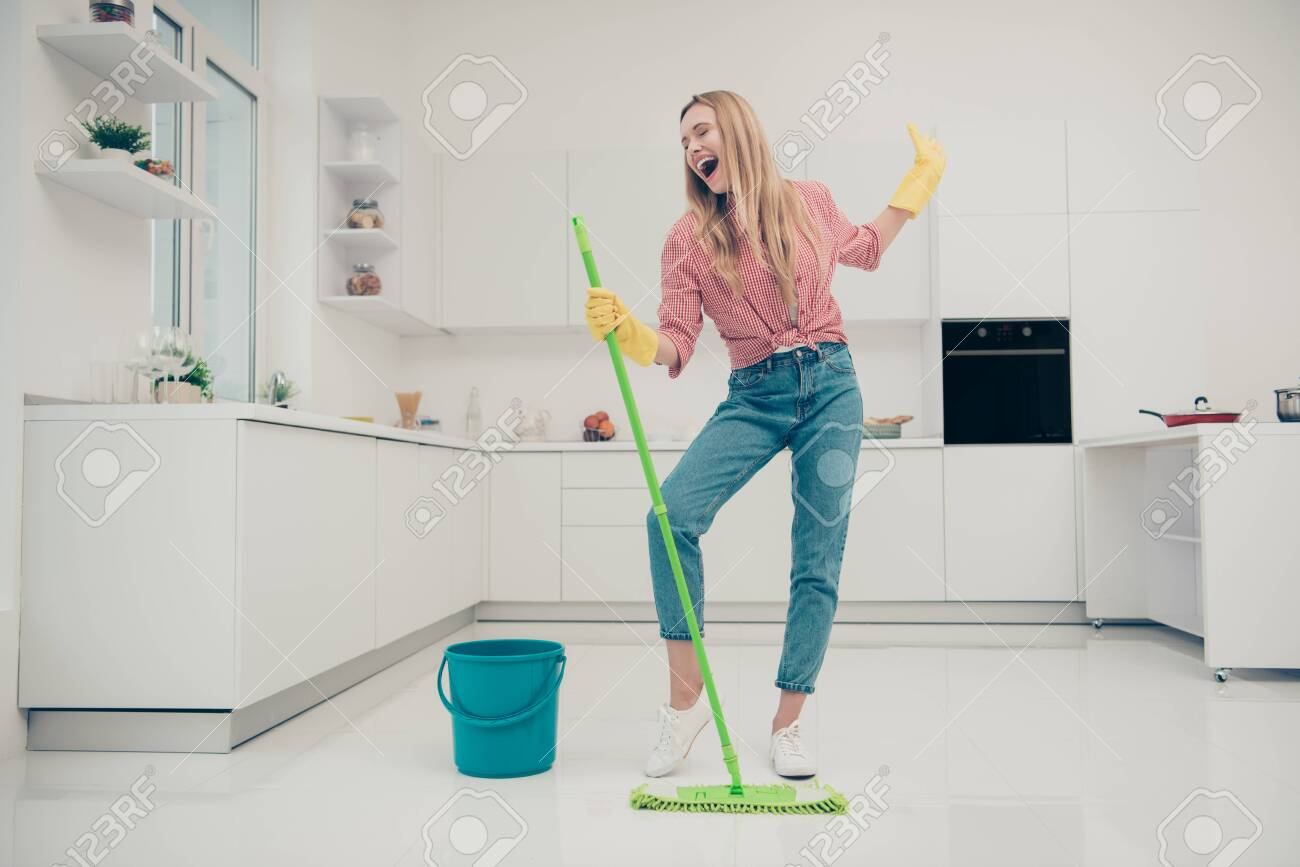 Full length body size photo beautiful amazing funky she her lady wash white floor housemaid karaoke day singing mop crazy movement wear jeans denim casual plaid checkered shirt bright light kitchen - 123895873