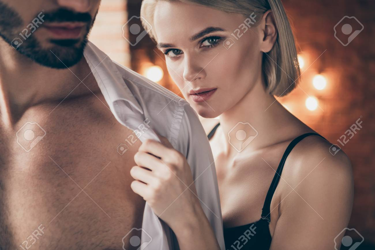 Cropped close up photo hot two people partners she her lady touch hands he him his handsome shoulders taking off white shirt wife husband anniversary morning full wish want eager house room indoors - 123954962