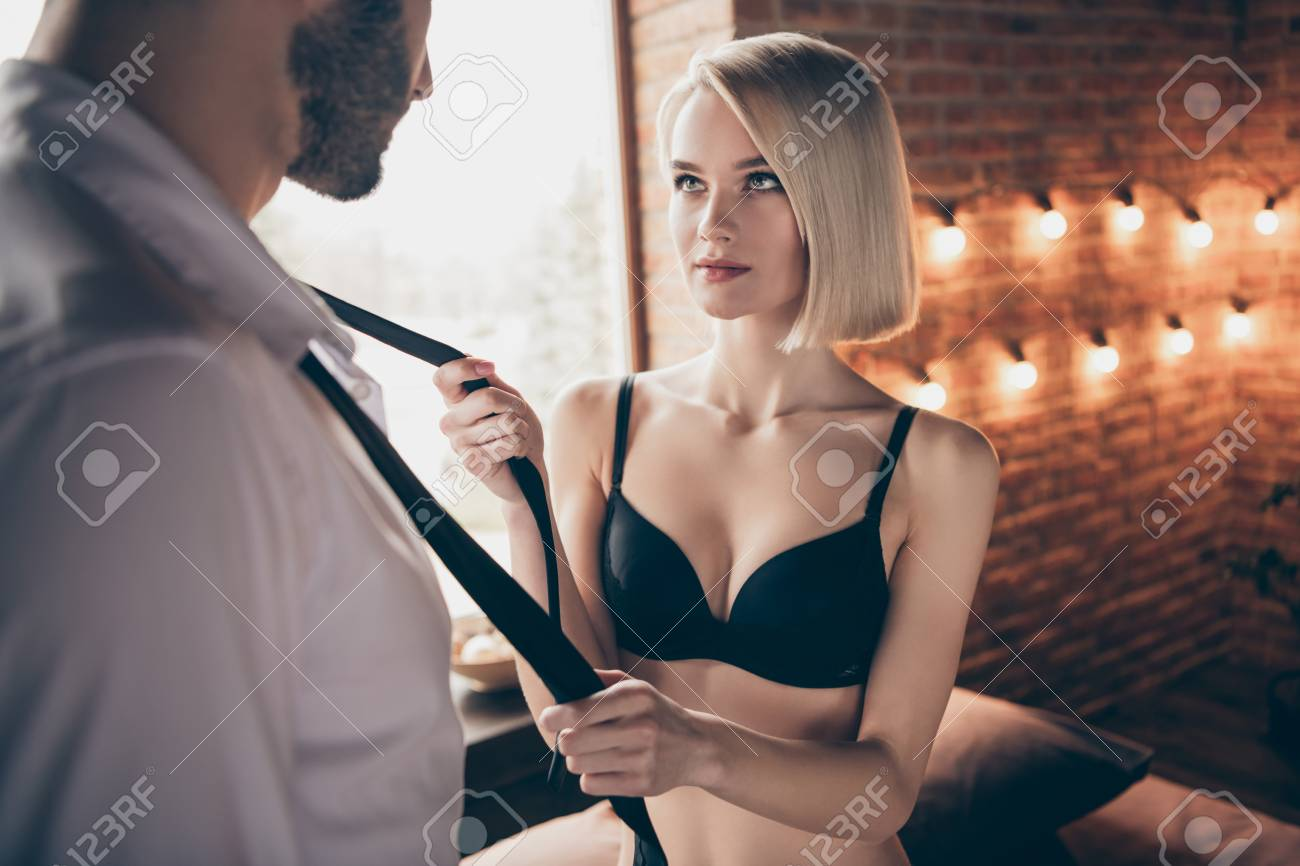 Portrait of two person nice-looking lovable sweet stunning gorgeous attractive feminine lady teasing businessman successful guy in loft brick industrial style interior room house hotel indoors - 123954969