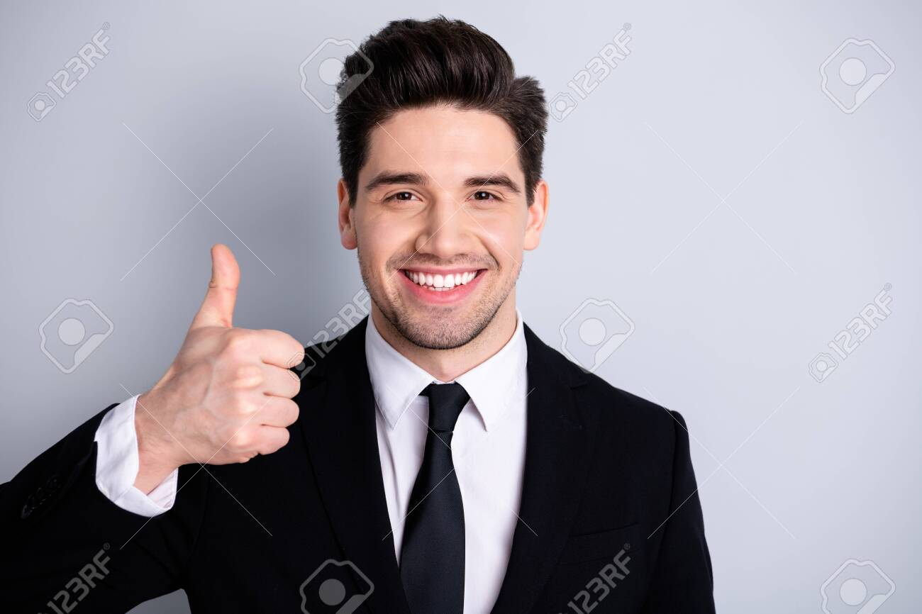 Close up photo amazing he him his macho handsome hand arm thumb up advising buy buyer new tested great product wear white shirt black suit jacket tie formal-wear isolated bright grey background - 122699233