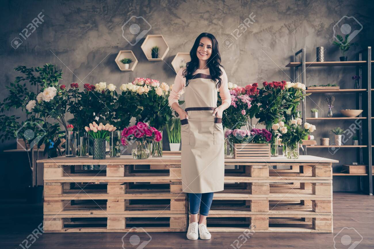 Full length body size view portrait of her she nice attractive lovely charming cute cheerful cheery mature wavy-haired brunette lady new decorative retail place workstation - 123920545