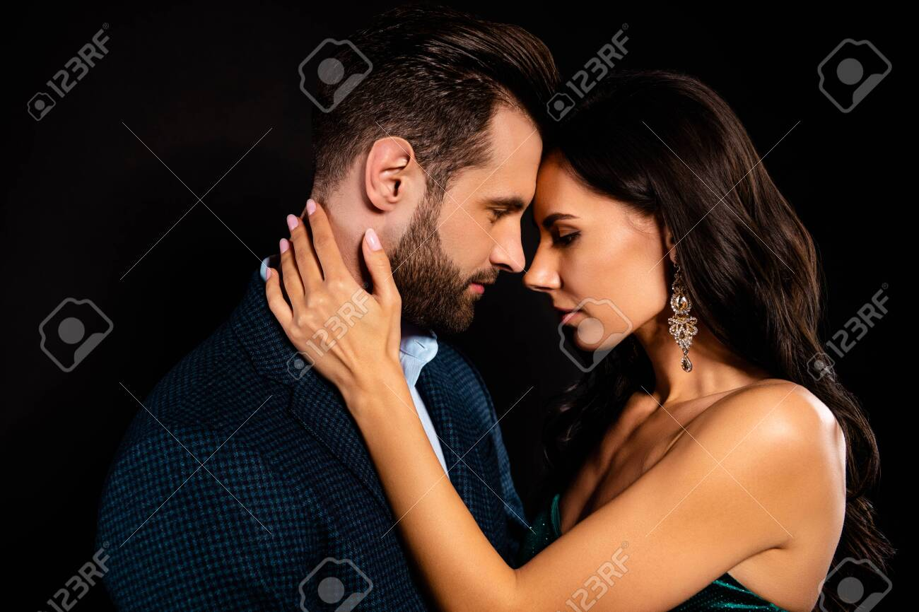 Close-up profile side view portrait of his he her she nice-looking attractive lovely luxurious passionate two person caressing St Valentine day event isolated over black background - 126778969