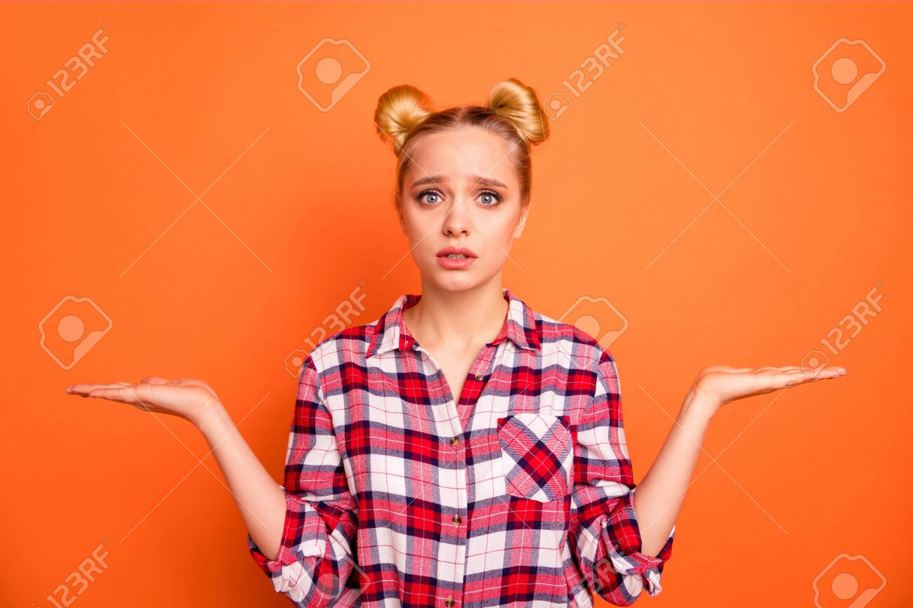 Close up photo beautiful fear she her lady perfect appearance hold open hands arms products not sure which one use select pick wear casual checkered plaid pink shirt isolated bright orange background - 127523674