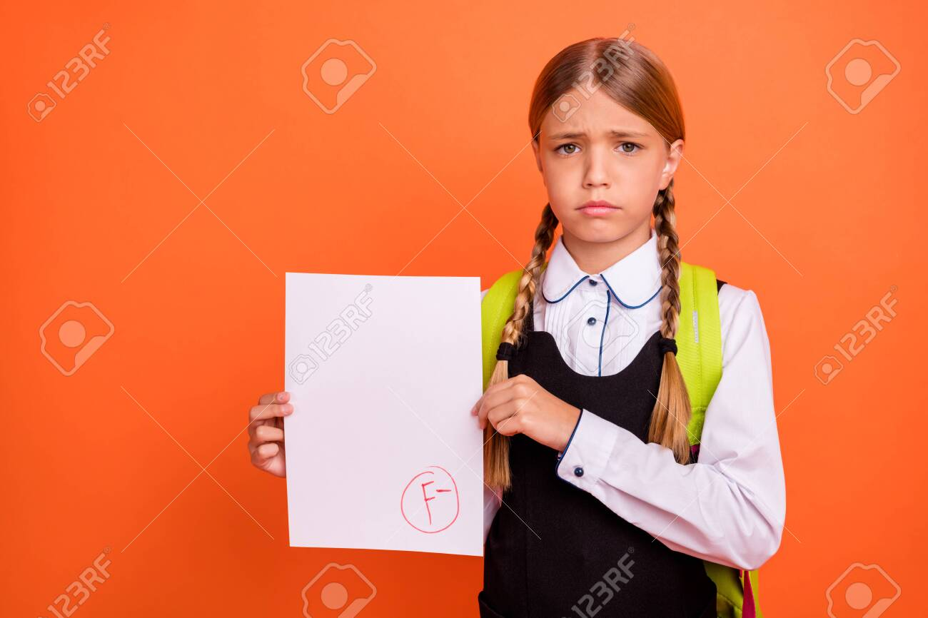 Portrait of her she nice attractive lovely disappointed unlucky pre-teen blonde girl showing bad fiasco mark score first grade isolated on bright vivid shine orange background - 128471750
