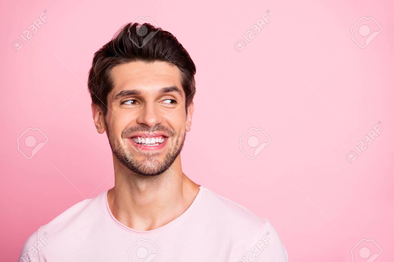 Closeup photo of amazing guy look silly empty space wearing casual outfit isolated on pink background - 128565601