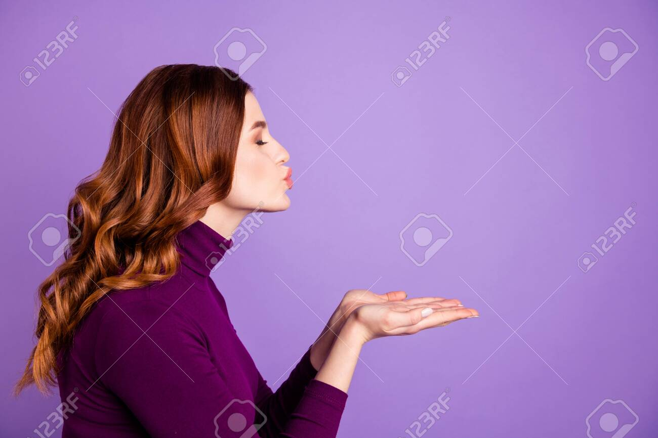 Profile side photo of charming lady send air kisses close eyes