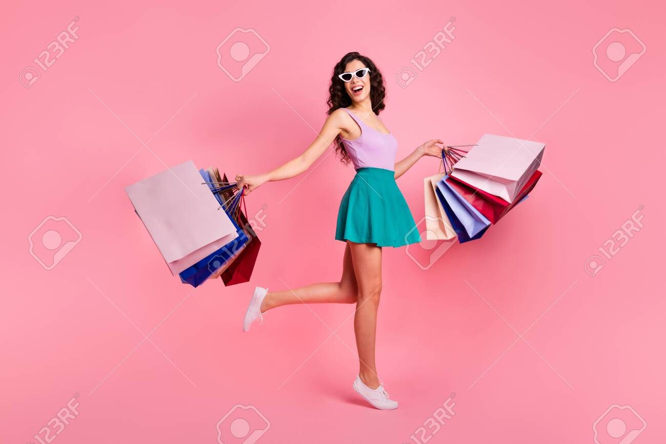 Full length body size photo of cheerful trendy stylish carefree cute attractive gorgeous woman rejoicing with sales wearing teal skirt while isolated with pastel background - 129733567