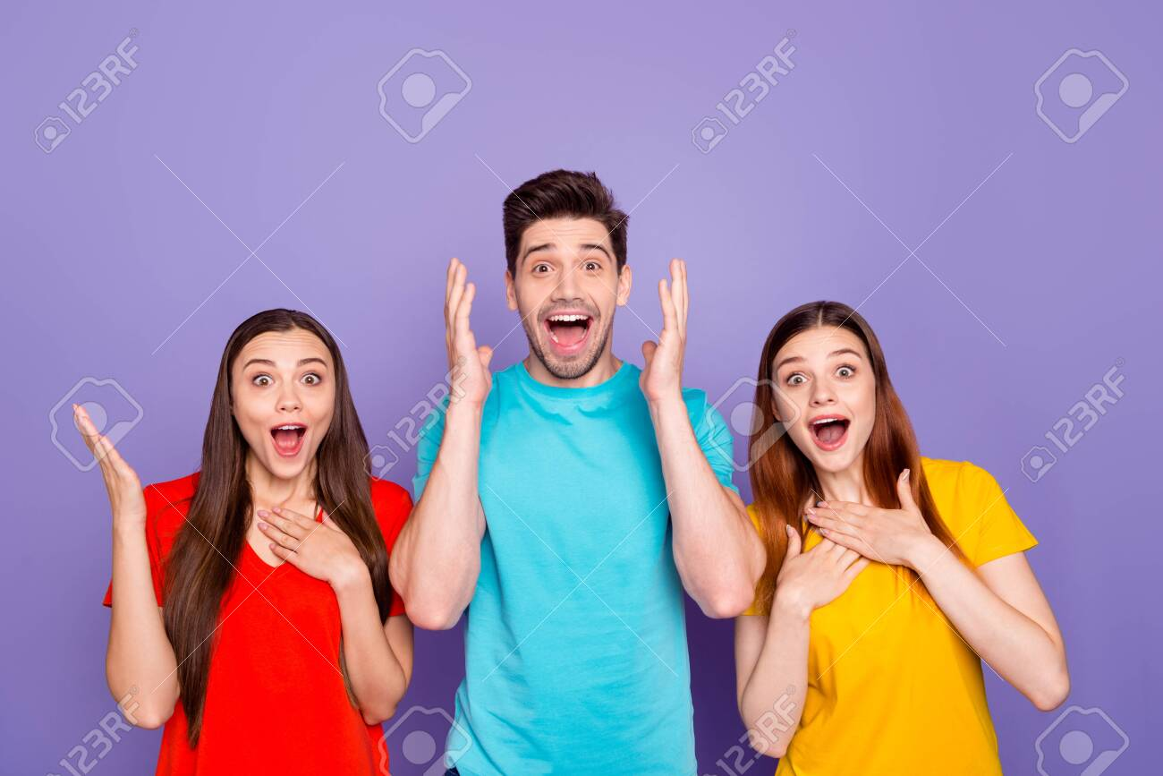 Portrait of nice-looking attractive lovely charming cheerful cheery guys wearing colorful t-shirts showing astonishment expression isolated over violet lilac background - 131542004