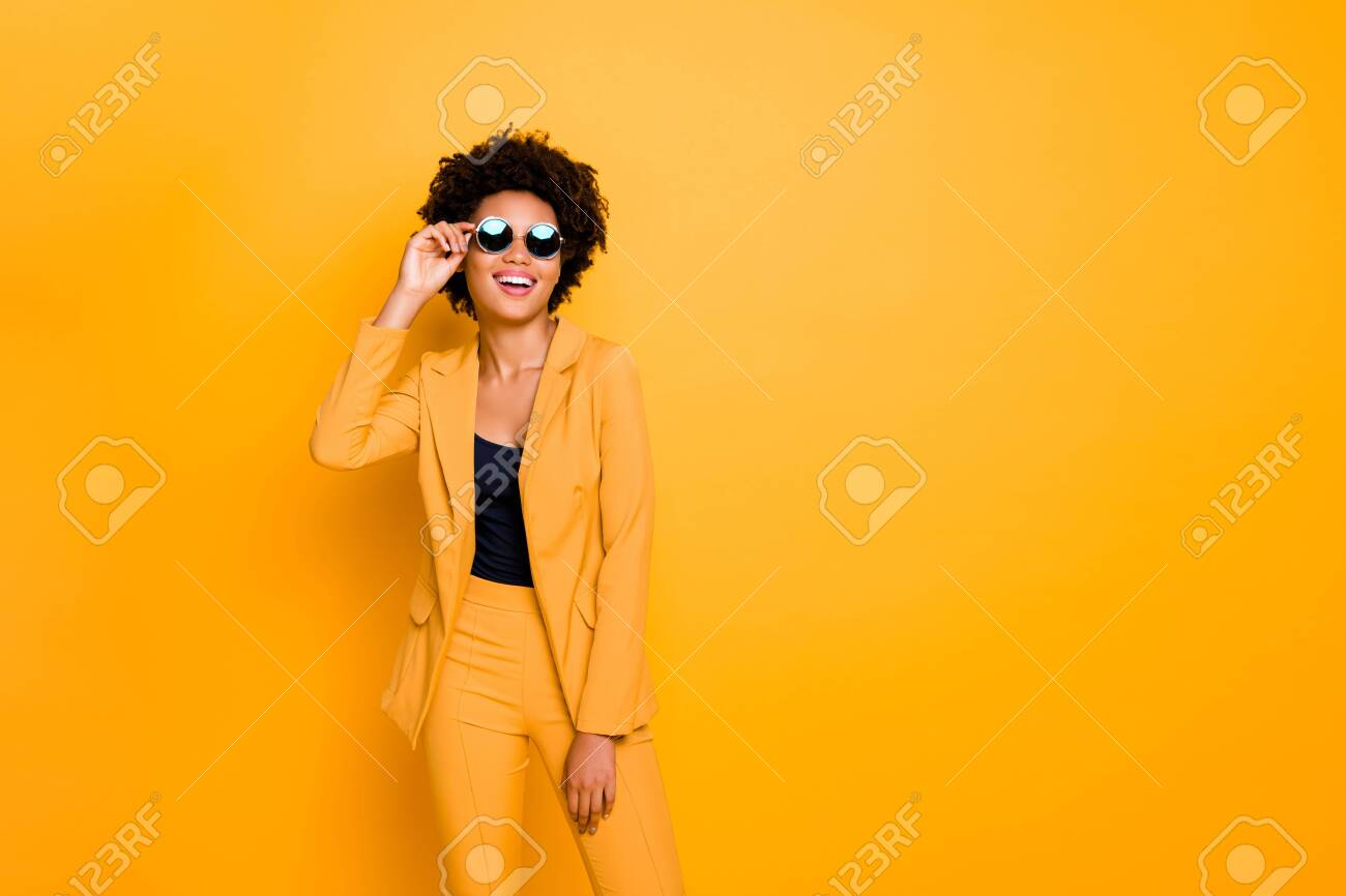Portrait of her she nice fashionable attractive luxurious cheerful cheery wavy-haired girl touching specs isolated over bright vivid shine vibrant yellow color background - 132375493