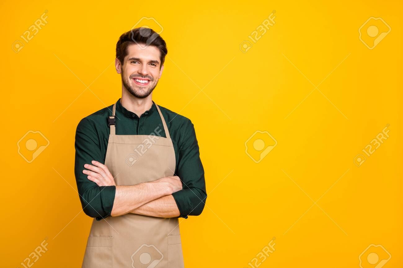 Photo of white cheerful positive man smiling toothily with arms crossed expressing positive emotions on face near empty space isolated bright color background - 133740089