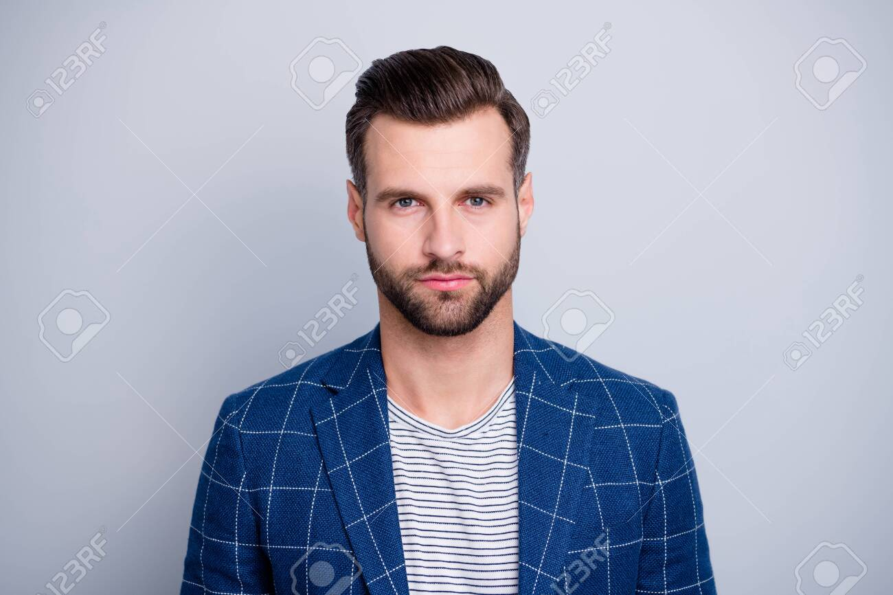 Close-up portrait of his he nice well-groomed serious attractive calm bearded guy wearing checked blazer isolated over light grey pastel color background - 134636632