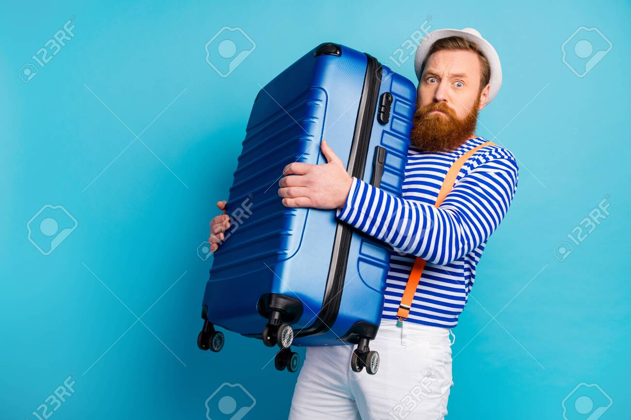 Portrait of serious man bad moody hold heavy luggage he prepare for voyage weekend tourism resort airport wear good look vest isolated over blue color background - 138776100