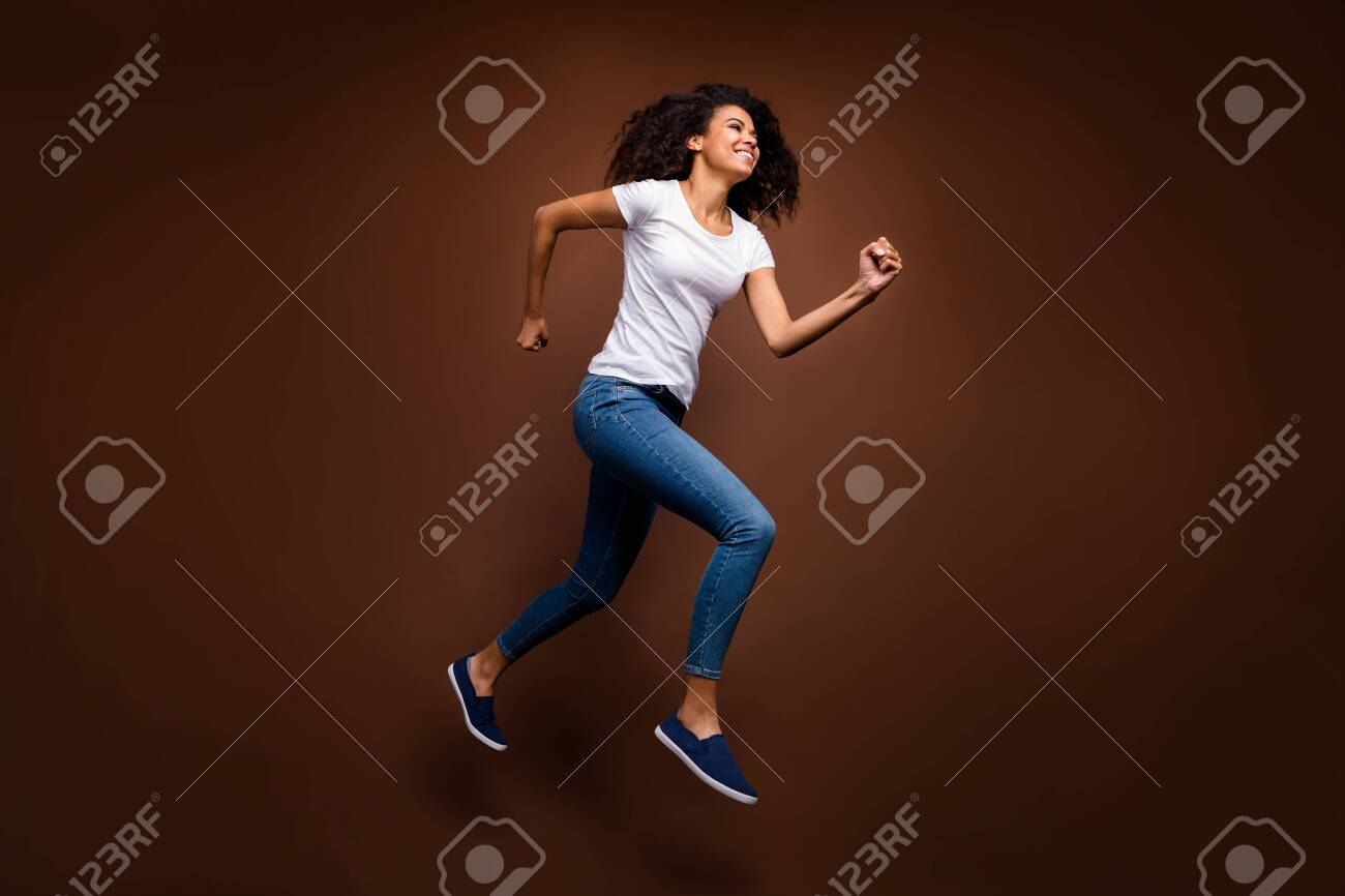 Full Size Profile Photo Of Funny Dark Skin Lady Jumping High Stock Photo Picture And Royalty Free Image Image 138825240
