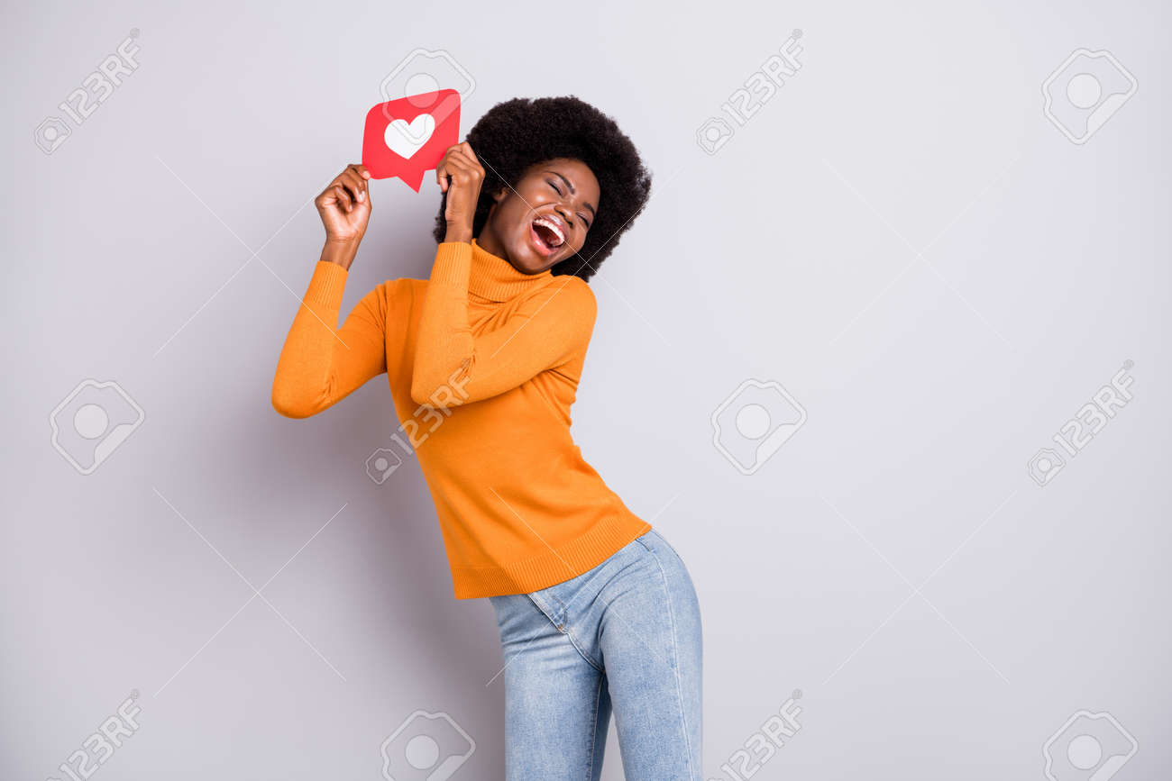 Photo of young black woman happy positive smile hold heart like reaction icon click popular isolated over grey color background - 167744616