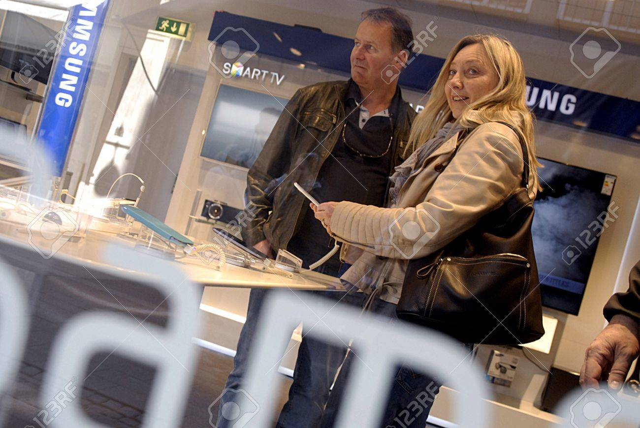 Copenhagen / Denmark._Consumers at Samsung products center in radio and television store 20 April 2013      Stock Photo - 19184178