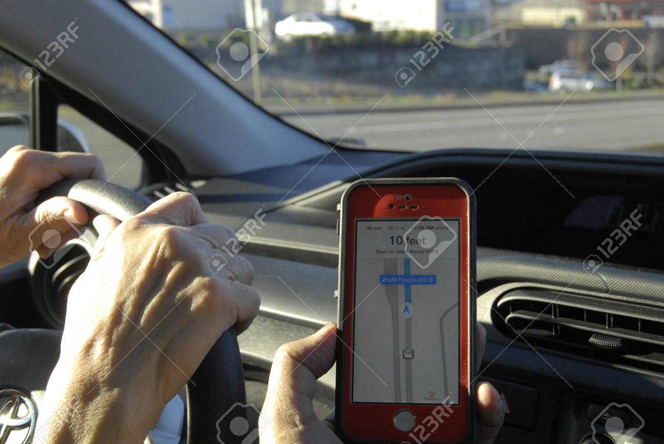 Seattle Washington State Usa Driver Using Map Quest At Iphone