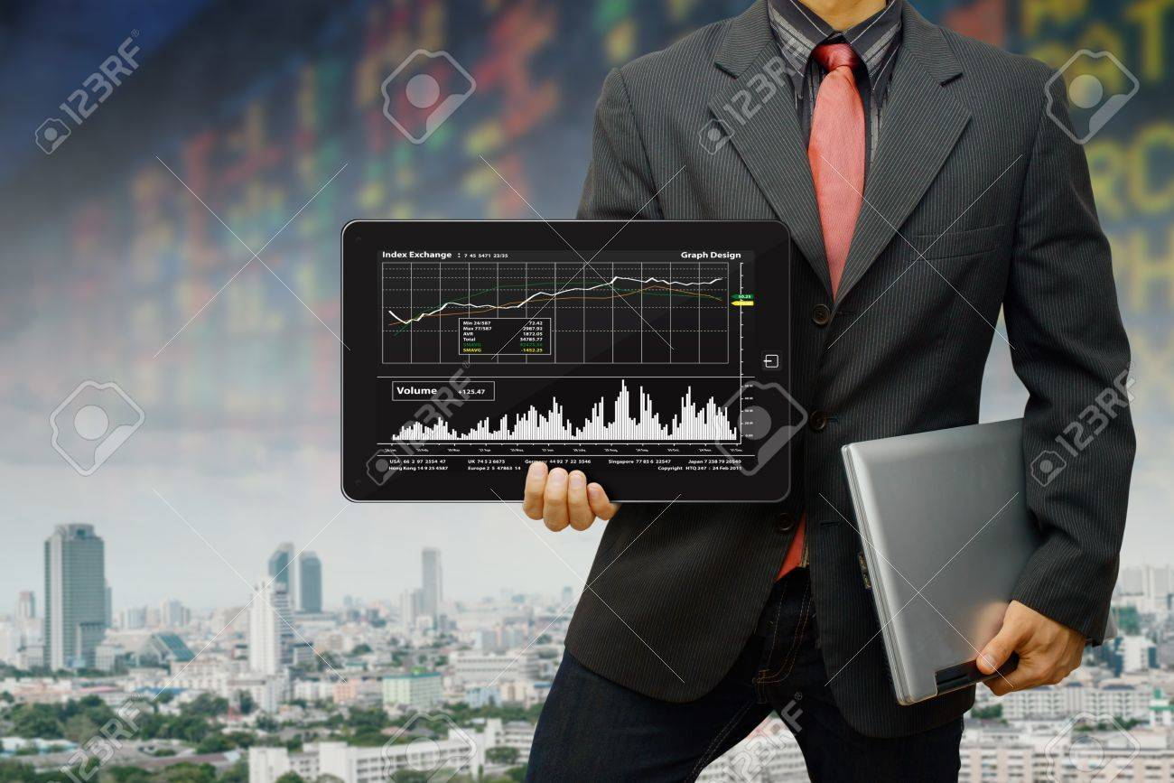 Business man and graph report Stock Photo - 14396508