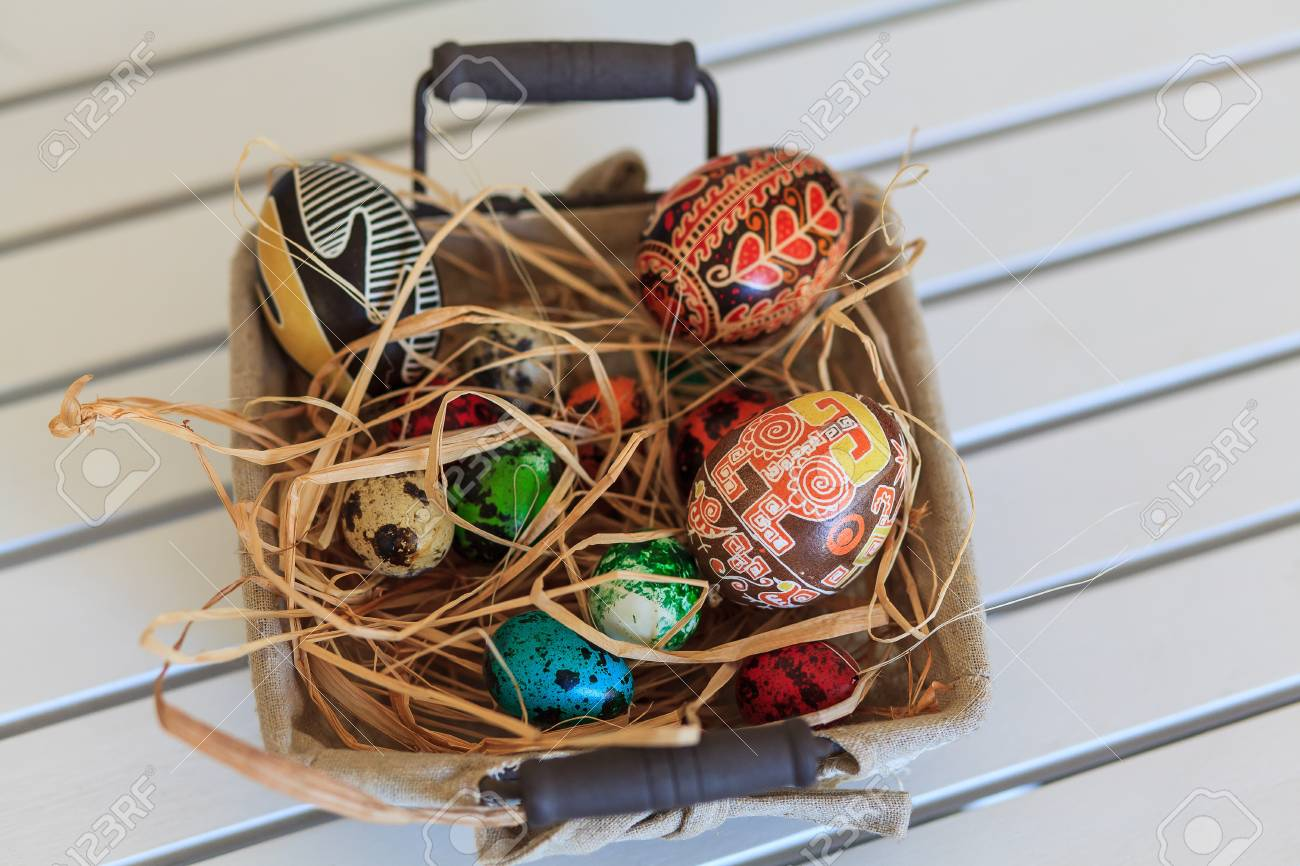 Bunch of colorful Easter eggs in a basket Stock Photo - 18961453