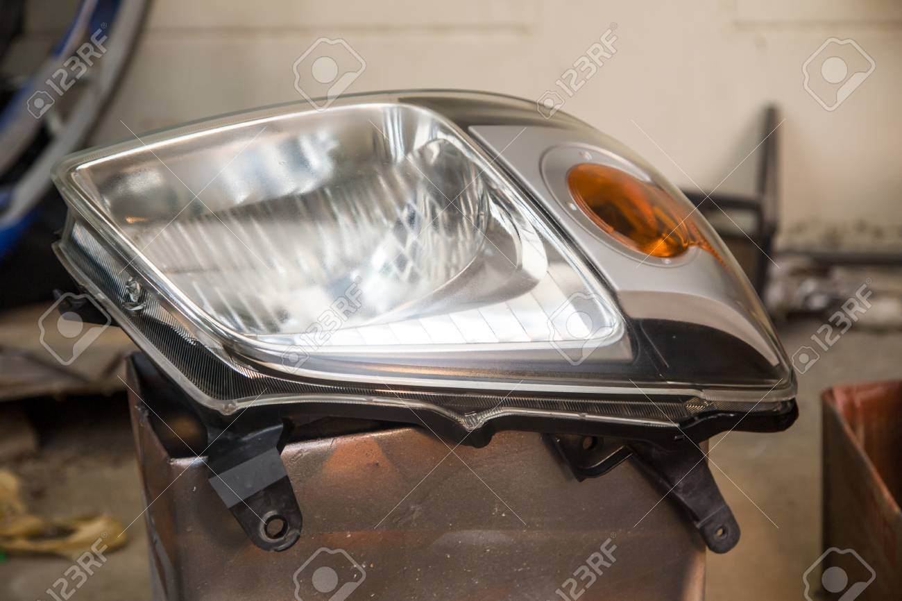Car Headlight For Repair Polishing And Coating Stock Photo Picture