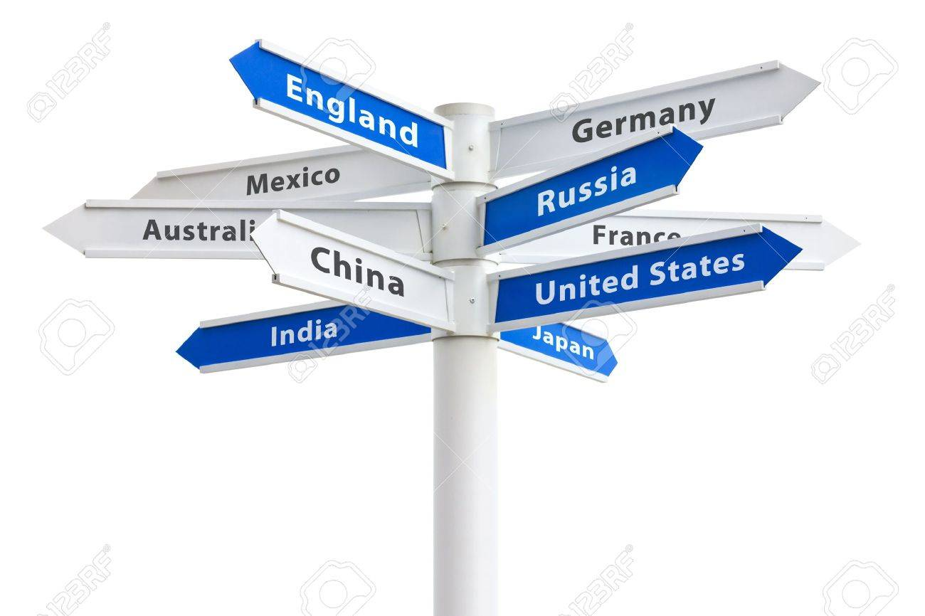 Arrows pointing to different countries of the world on a crossroads sign Stock Photo - 13564779