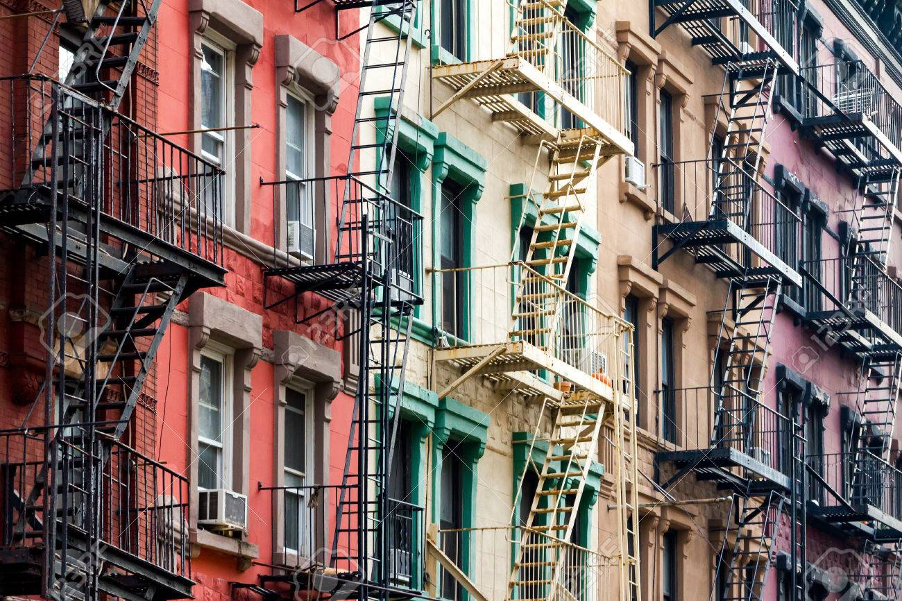 NYC Block Of Rainbow Colored Apartment Buildings In Manhattan, New York  City Stock Photo
