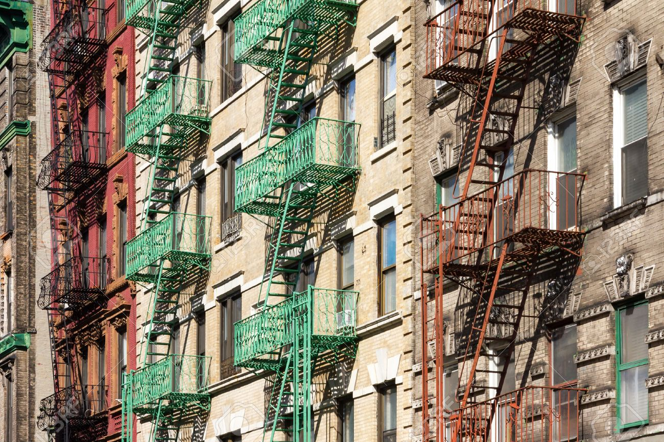 nyc apartment buildings. New York City Block of Colorful Apartment Buildings with Fire Escapes in  Manhattan Stock Photo Of With