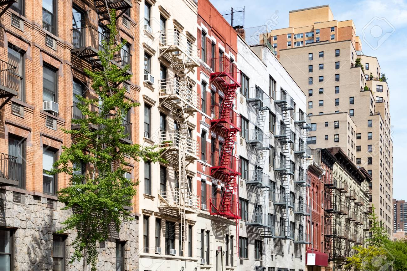 block of colorful old apartment buildings in the east village