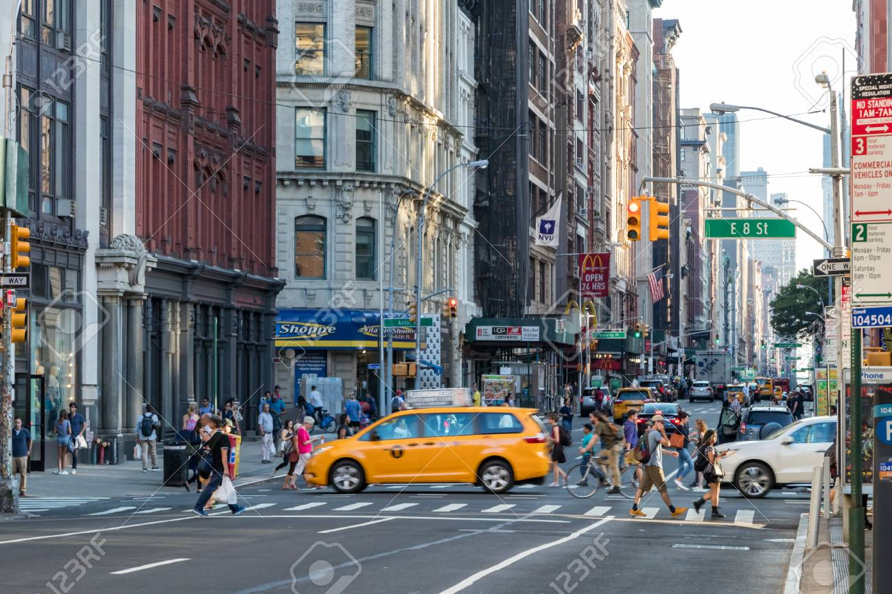 NEW YORK CITY - CIRCA 2017: People and cars cross the busy intersection