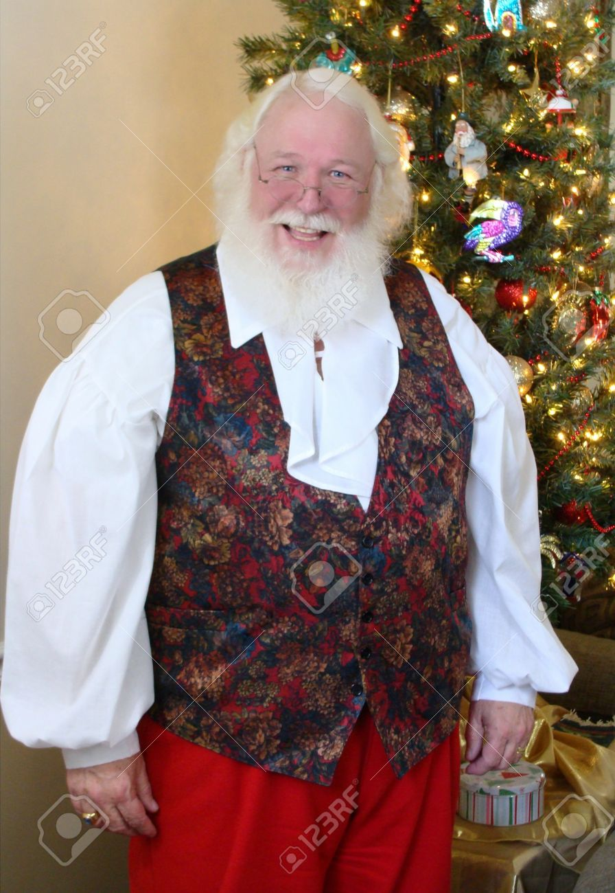 Christmas Vest.Santa Claus In A Christmas Vest By The Tree