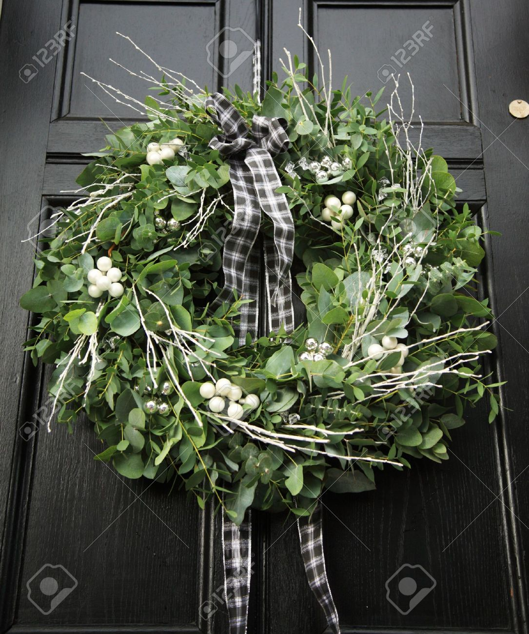 Eucalyptus Christmas Wreath Hung On A Black Door Stock Photo Picture And Royalty Free Image Image 3735873